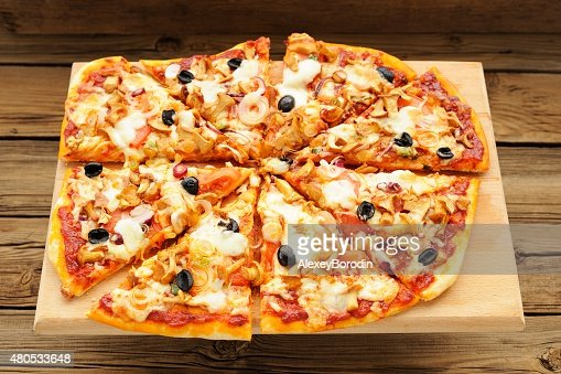 Al funghi pizza with olives cut : Stock Photo