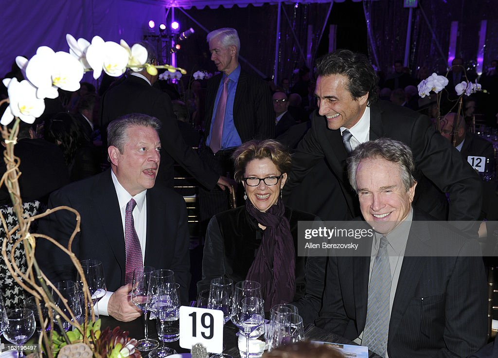 <a gi-track='captionPersonalityLinkClicked' href=/galleries/search?phrase=Al+Gore&family=editorial&specificpeople=119691 ng-click='$event.stopPropagation()'>Al Gore</a>, actress <a gi-track='captionPersonalityLinkClicked' href=/galleries/search?phrase=Annette+Bening&family=editorial&specificpeople=202568 ng-click='$event.stopPropagation()'>Annette Bening</a>, producer Laurence Bender and actor <a gi-track='captionPersonalityLinkClicked' href=/galleries/search?phrase=Warren+Beatty&family=editorial&specificpeople=201478 ng-click='$event.stopPropagation()'>Warren Beatty</a> attend UCLA Institute Of The Environment And Sustainability's 2nd Annual 'An Evening Of Environmental Excellence' - Inside on March 5, 2013 in Beverly Hills, California.