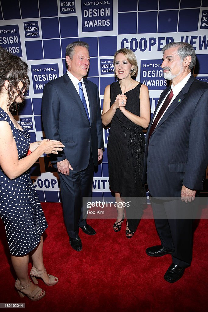 Al Gore (2nd L) and Caroline Baumann, with guests attend the 2013 Cooper-Hewitt National Design Awards at Pier 60 on October 17, 2013 in New York City.