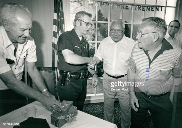 Al Hague retiring Denver Police officer was congagulated by friends at a party held for him At Wyatts Cafeteria The Bear Valley Coffee Club about 50...