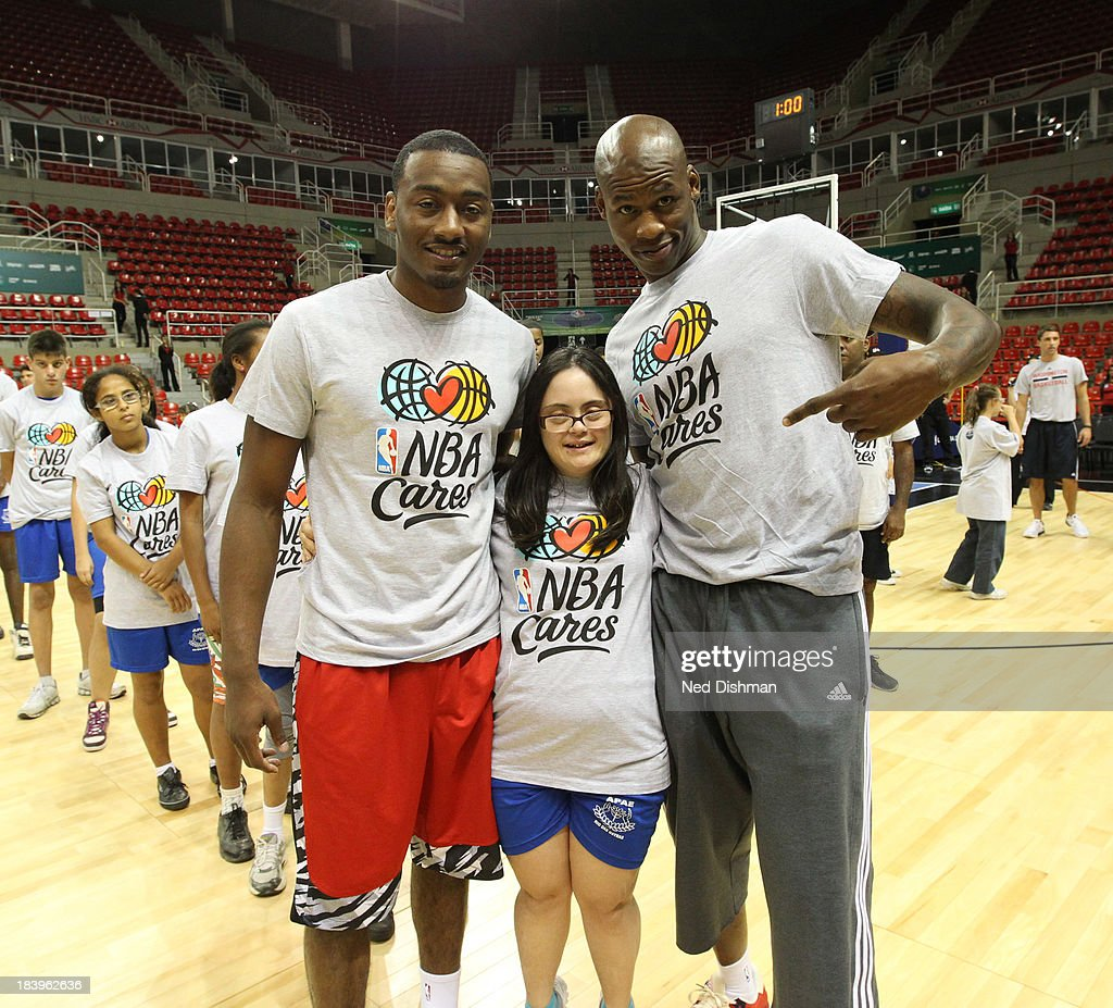 Al Harrington and John Wall of the Washington Wizards pose with a fan during a Special Olympics Basketball Clinic as part of 2013 Global Games on October 10, 2013 at HSBC Arena in Rio de Janiero, Brazil.