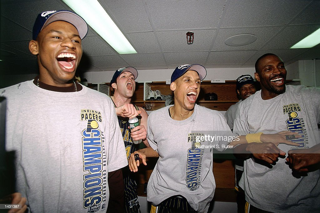 Al Harrington Austin Croshere Reggie Miller and Dale Davis of the Indiana Pacers celebrate in the lockerroom after winning game 6 of the Eastern...