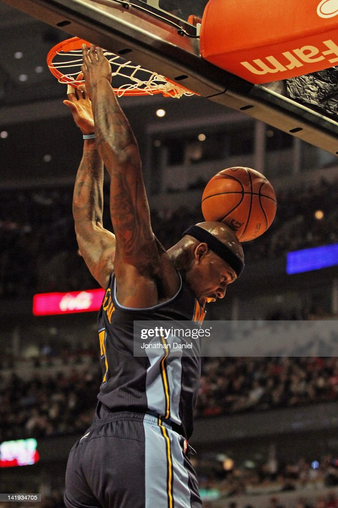<a gi-track='captionPersonalityLinkClicked' href=/galleries/search?phrase=Al+Harrington&family=editorial&specificpeople=201645 ng-click='$event.stopPropagation()'>Al Harrington</a> #7 of the Denver Nuggets bounces the ball off of his head after dunking against the Chicago Bulls at the United Center on March 26, 2012 in Chicago, Illinois.