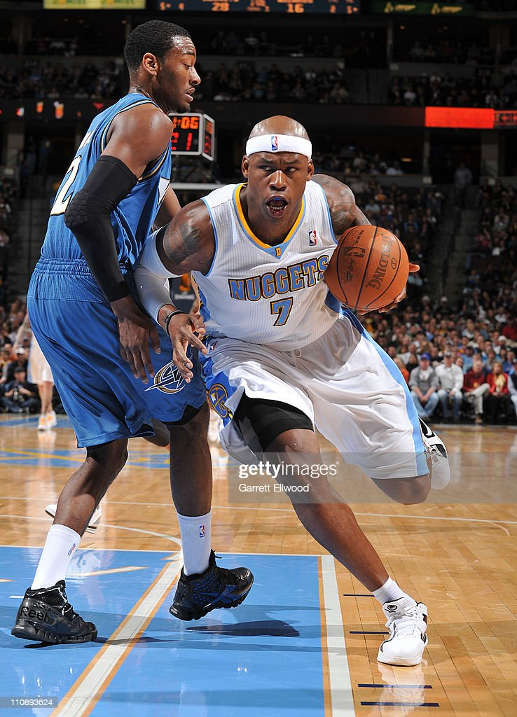 <a gi-track='captionPersonalityLinkClicked' href=/galleries/search?phrase=Al+Harrington&family=editorial&specificpeople=201645 ng-click='$event.stopPropagation()'>Al Harrington</a> #7 of the Denver Nuggets drives to the basket against <a gi-track='captionPersonalityLinkClicked' href=/galleries/search?phrase=John+Wall&family=editorial&specificpeople=2265812 ng-click='$event.stopPropagation()'>John Wall</a> #2 of the Washington Wizards on March 25, 2011 at the Pepsi Center in Denver, Colorado.
