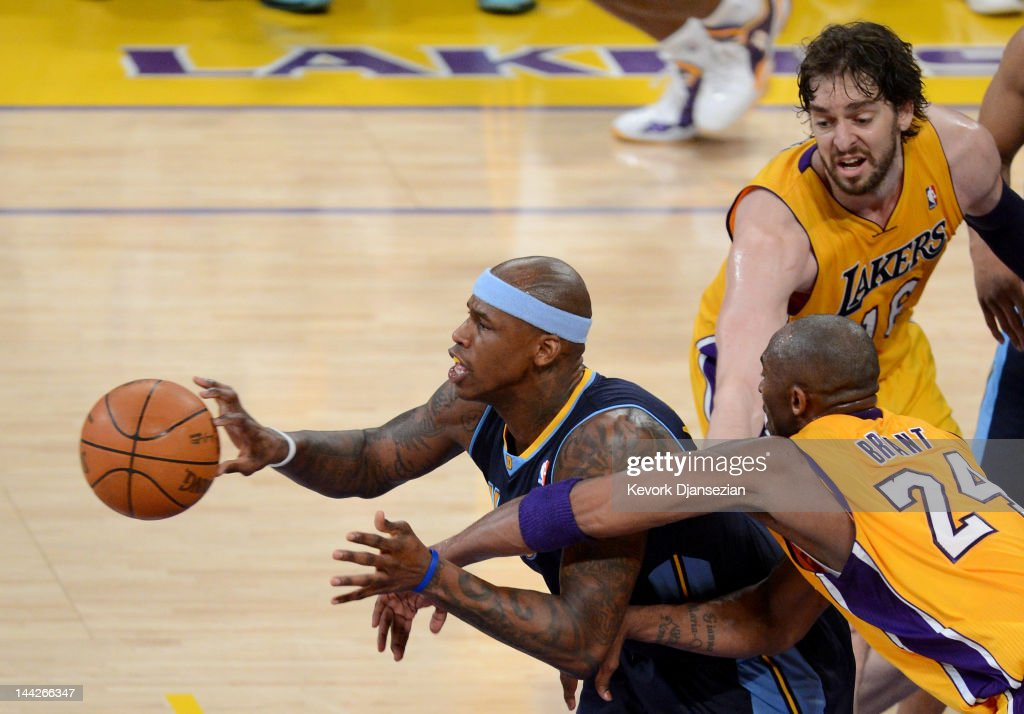 <a gi-track='captionPersonalityLinkClicked' href=/galleries/search?phrase=Al+Harrington&family=editorial&specificpeople=201645 ng-click='$event.stopPropagation()'>Al Harrington</a> #7 of the Denver Nuggets moves the ball in front of <a gi-track='captionPersonalityLinkClicked' href=/galleries/search?phrase=Kobe+Bryant&family=editorial&specificpeople=201466 ng-click='$event.stopPropagation()'>Kobe Bryant</a> #24 and <a gi-track='captionPersonalityLinkClicked' href=/galleries/search?phrase=Pau+Gasol&family=editorial&specificpeople=201587 ng-click='$event.stopPropagation()'>Pau Gasol</a> #16 of the Los Angeles Lakers in the second half in Game Seven of the Western Conference Quarterfinals in the 2012 NBA Playoffs on May 12, 2012 at Staples Center in Los Angeles, California.