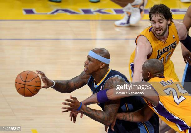 Al Harrington of the Denver Nuggets moves the ball in front of Kobe Bryant and Pau Gasol of the Los Angeles Lakers in the second half in Game Seven...