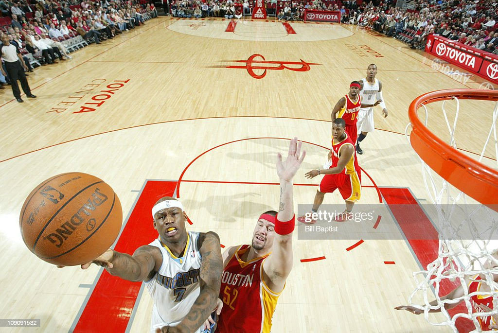 Al Harrington #7 of the Denver Nuggets shoots the ball over Brad Miller #52 of the Houston Rockets on February 14, 2011 at the Toyota Center in Houston, Texas.