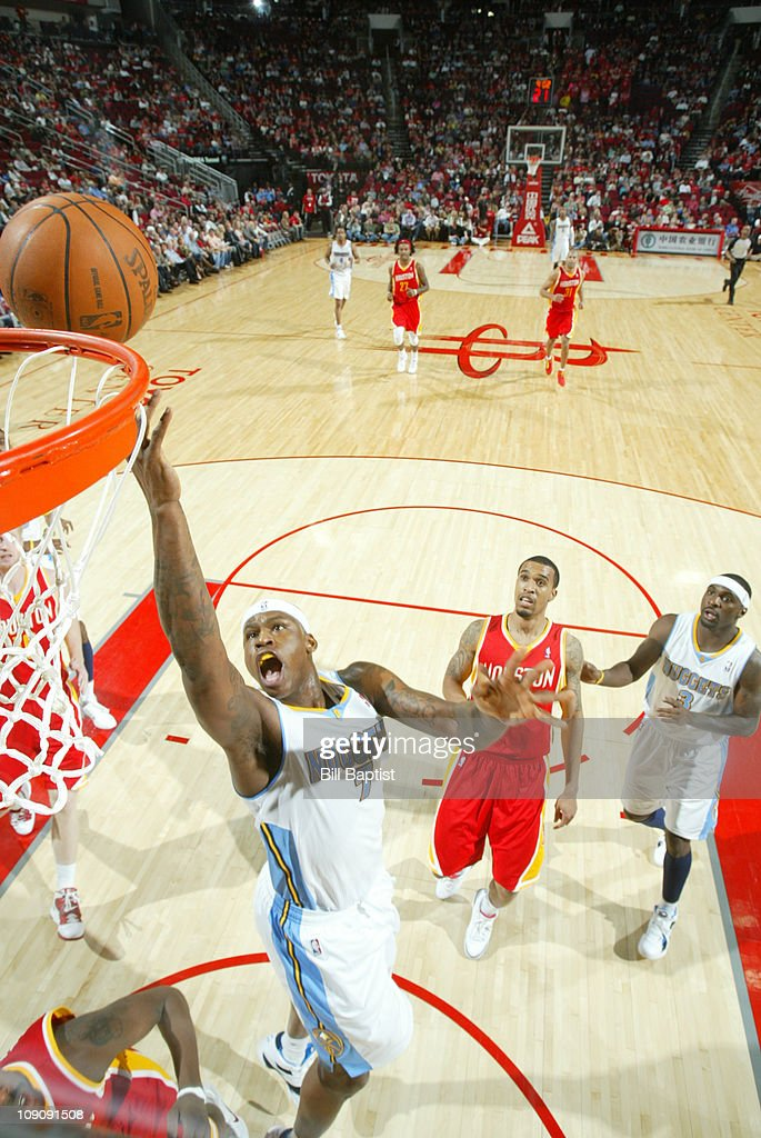 Al Harrington #7 of the Denver Nuggets shoots the ball over Courtney Lee #5 of the Houston Rockets on February 14, 2011 at the Toyota Center in Houston, Texas.