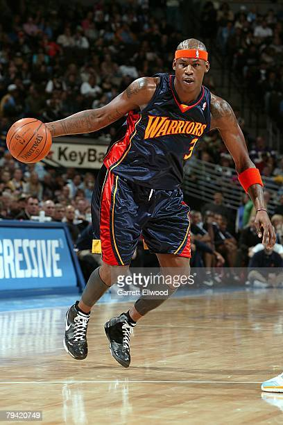 Al Harrington of the Golden State Warriors moves the ball during the NBA game against the Denver Nuggets on December 30 2007 at the Pepsi Center in...