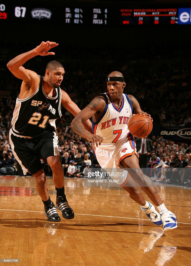 Al Harrington #7 of the New York Knicks drives against Tim Duncan #21 of the San Antonio Spurs on February 17, 2009 at Madison Square Garden in New York City.