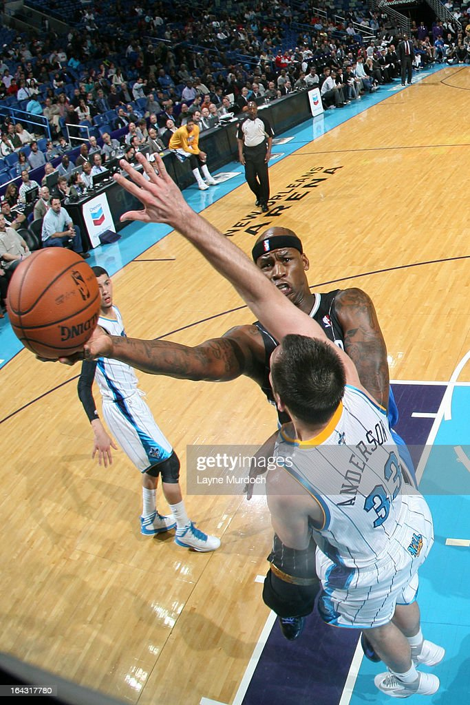 <a gi-track='captionPersonalityLinkClicked' href=/galleries/search?phrase=Al+Harrington&family=editorial&specificpeople=201645 ng-click='$event.stopPropagation()'>Al Harrington</a> #3 of the Orlando Magic drives to the basket against the New Orleans Hornets on March 4, 2013 at the New Orleans Arena in New Orleans, Louisiana.