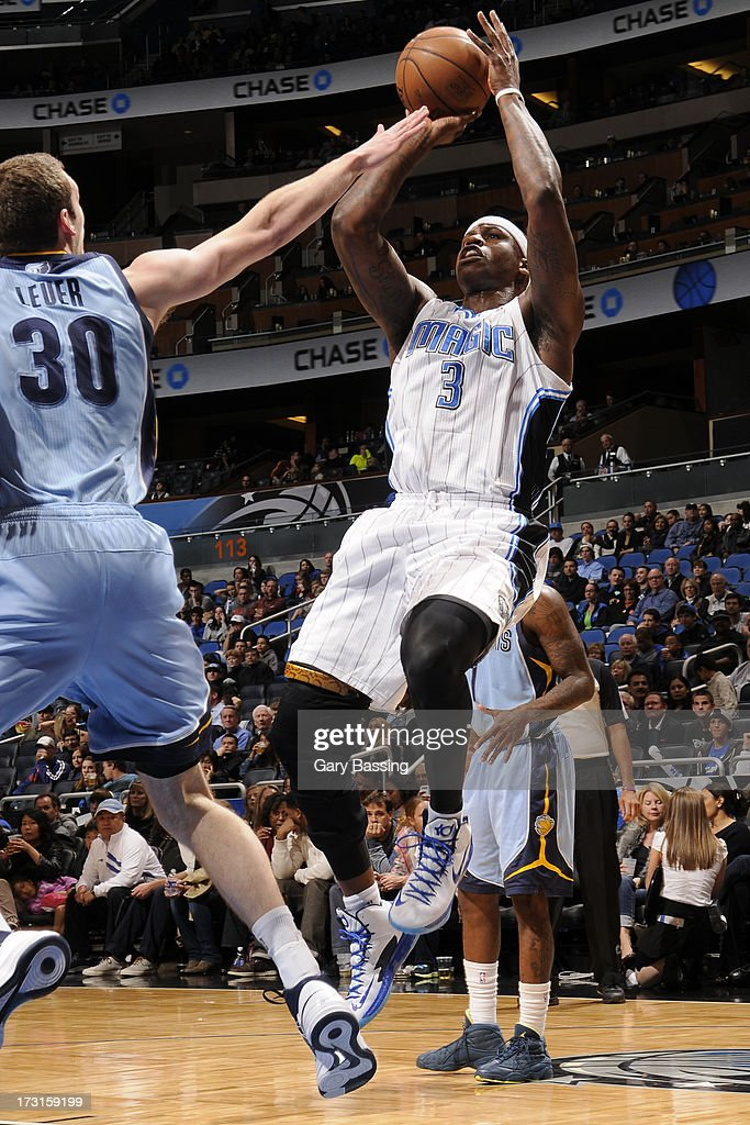 Al Harrington #3 of the Orlando Magic goes for a jump shot under pressure during the game between the Memphis Grizzlies and the Orlando Magic on March 3, 2013 at Amway Center in Orlando, Florida.