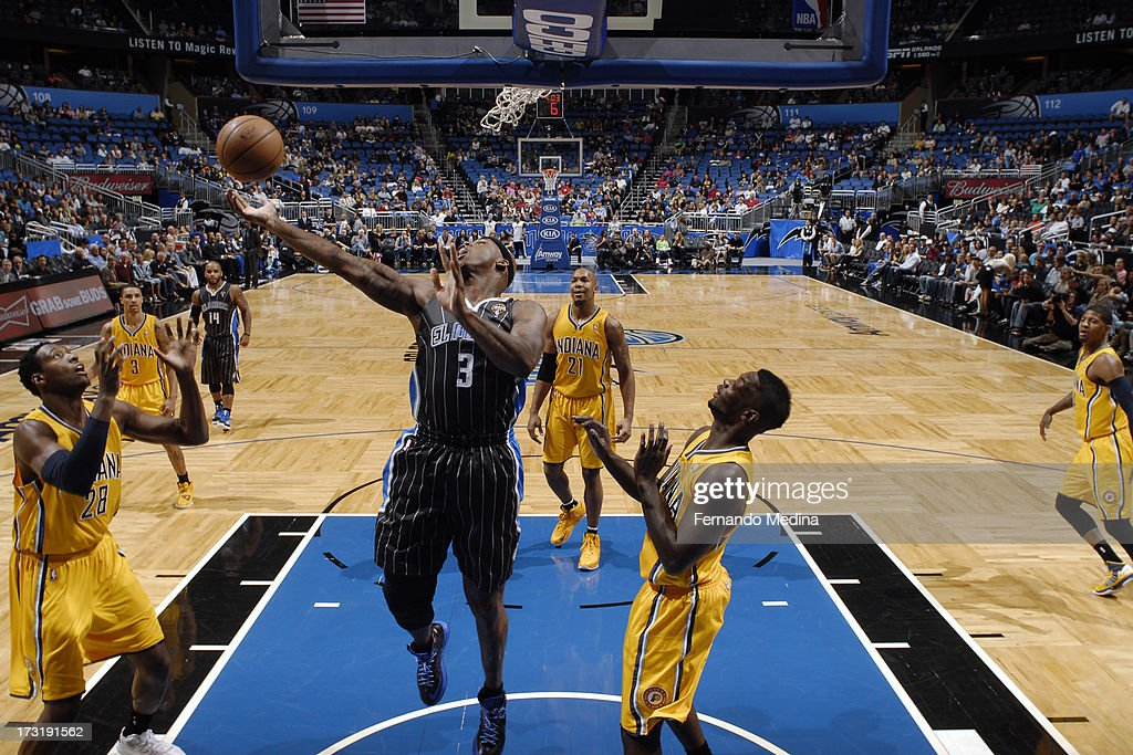 Al Harrington #3 of the Orlando Magic reaches for a rebound against the Indiana Pacers on March 8, 2013 at Amway Center in Orlando, Florida.