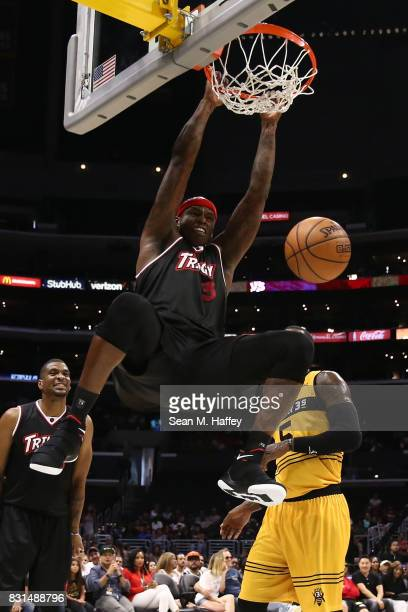 Al Harrington of the Trilogy dunks against the Killer 3s during week eight of the BIG3 three on three basketball league at Staples Center on August...
