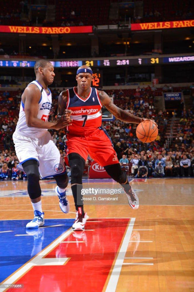 Al Harrington #7 of the Washington Wizards drives to the basket against Lavoy Allen #50 of the Philadelphia 76ers at the Wells Fargo Center on November 6, 2013 in Philadelphia, Pennsylvania.