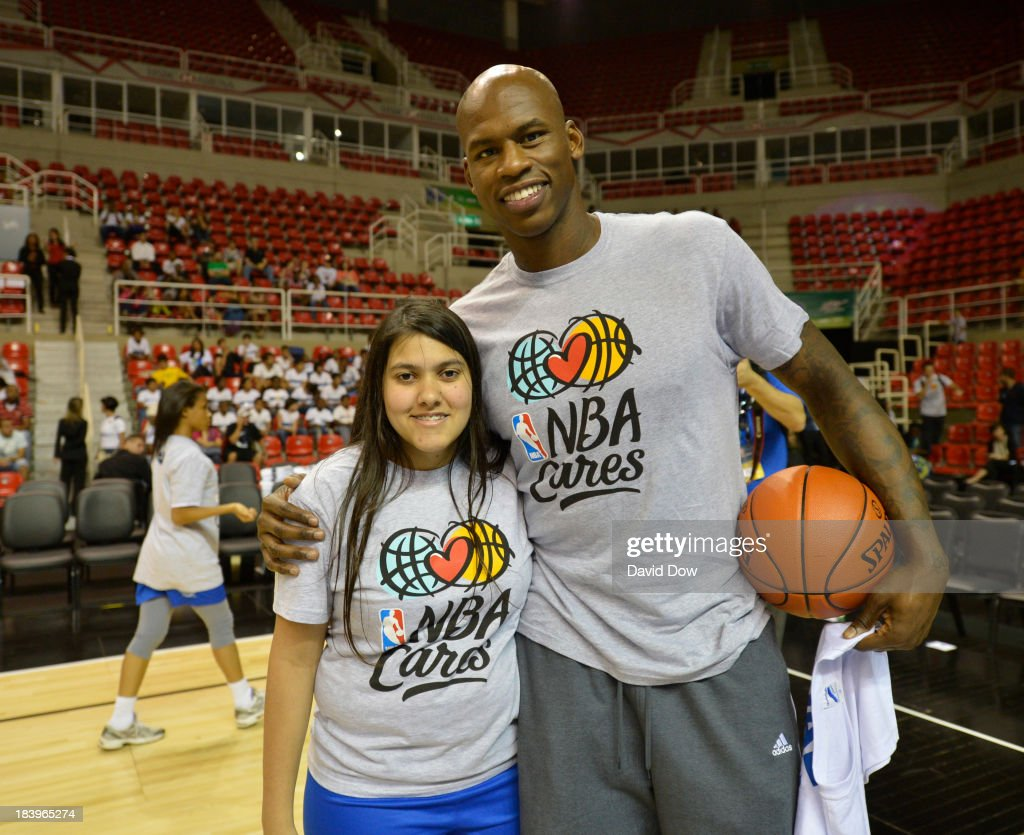 Al Harrington of the Washington Wizards poses with a fan during a Special Olympics Basketball Clinic as part of 2013 Global Games on October 10, 2013 at HSBC Arena in Rio de Janiero, Brazil.