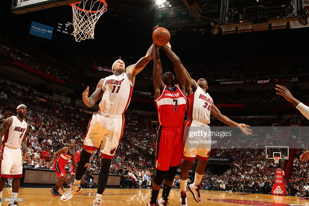 Al Harrington #7 of the Washington Wizards reaches for a rebound against Chris Andersen #11 and Norris Cole #30 of the Miami Heat on November 3, 2013 at American Airlines Arena in Miami, Florida.