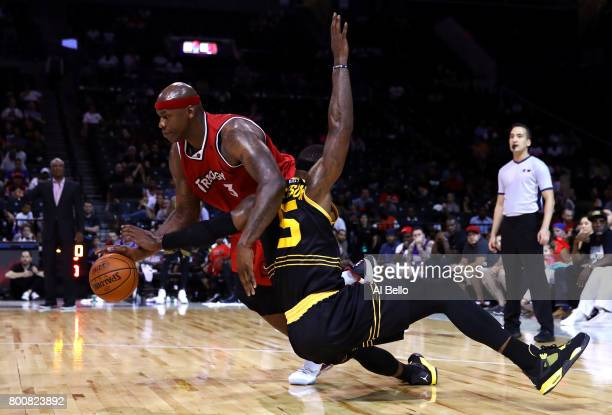 Al Harrington of Trilogy handles the ball against Stephen Jackson of the Killer 3s during week one of the BIG3 three on three basketball league at...