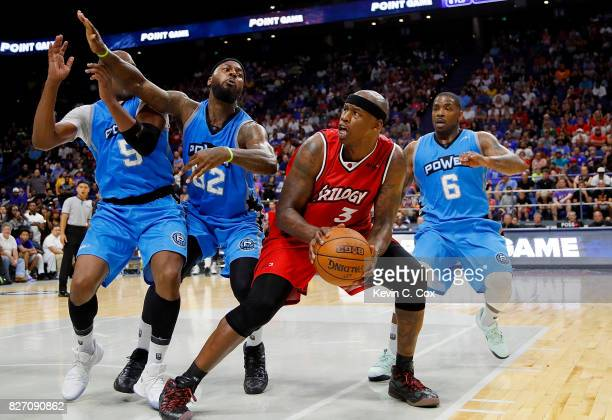 Al Harrington of Trilogy is guarded by three Power players as he attempts to drive to the basket during week seven of the BIG3 three on three...