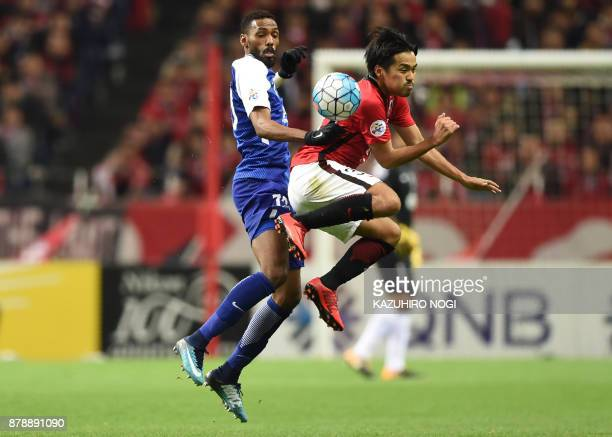 Al Hilal's defender Mohammed Jahfali fights for the ball with Urawa Red Diamonds' midfielder Shinzo Koroki during the second leg of the AFC Champions...