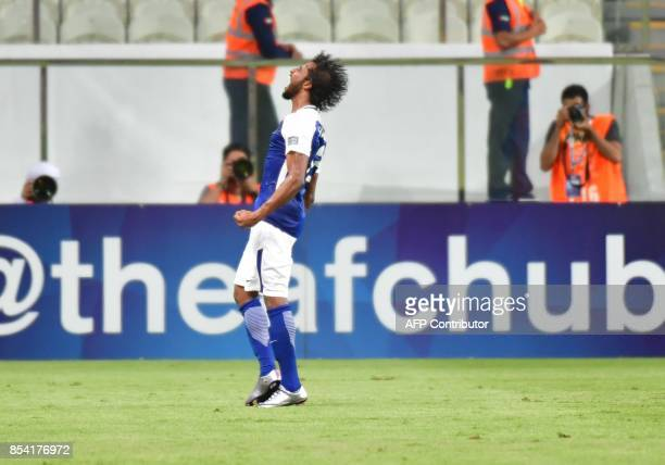 Al Hilal's defender Yasser AlShahrani celebrates after scoring during the first leg of their AFC Champions League semifinal football match at the...