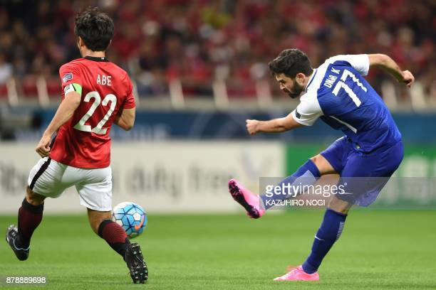 Al Hilal's forward Omar Khrbin shoots past Urawa Red Diamonds' midfielder Yuki Abe during the second leg of the AFC Champions League football final...