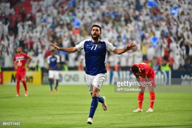 Al Hilal's forward Omar Khribin celebrates after scoring during the first leg of their AFC Champions League semifinal football match at the Mohammed...