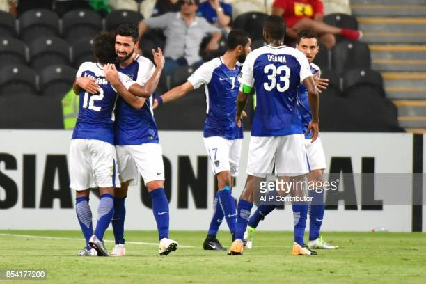Al Hilal's forward Omar Khribin celebrates with teammates after scoring during the first leg of their AFC Champions League semifinal football match...