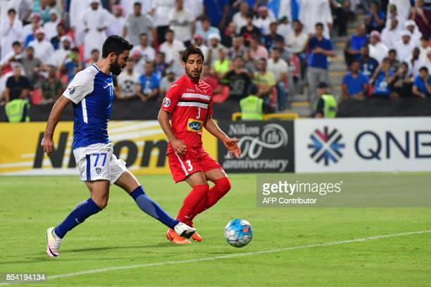 Al Hilal's forward Omar Khribin shoots to score during the first leg of their AFC Champions League semifinal football match at the Mohammed Bin Zayed...