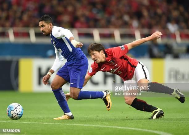 Al Hilal's midfielder Salem alDawsari runs past Urawa Red Diamonds' midfielder Tomoya Ugajin during the second leg of the AFC Champions League...