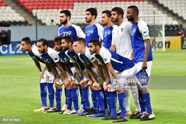 Al Hilal's starting eleven pose for a group picture ahead the first leg of their AFC Champions League semifinal football match against Persepolis at...