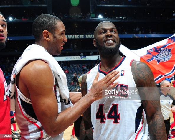 Al Horford and Ivan Johnson of the Atlanta Hawks smile after a victory against the Brooklyn Nets on January 16 2013 at Philips Arena in Atlanta...