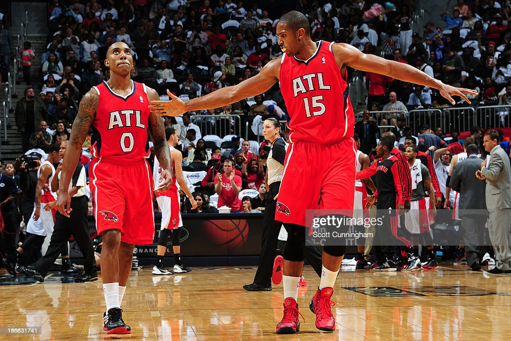 <a gi-track='captionPersonalityLinkClicked' href=/galleries/search?phrase=Al+Horford&family=editorial&specificpeople=699030 ng-click='$event.stopPropagation()'>Al Horford</a> #15 and <a gi-track='captionPersonalityLinkClicked' href=/galleries/search?phrase=Jeff+Teague&family=editorial&specificpeople=4680498 ng-click='$event.stopPropagation()'>Jeff Teague</a> #0 of the Atlanta Hawks celebrate against the Toronto Raptors on November 1, 2013 at Philips Arena in Atlanta, Georgia.