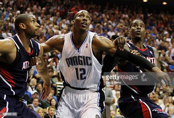 Al Horford and Marvin Williams of the Atlanta Hawks fight for position with Dwight Howard of the Orlando Magic in Game Two of the Eastern Conference...