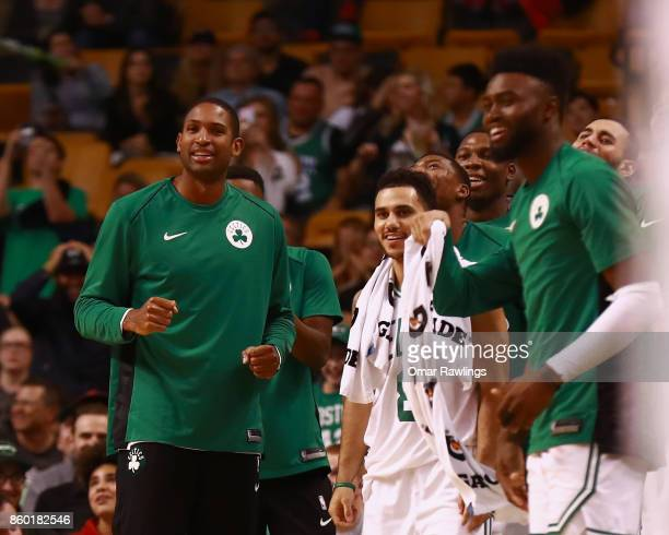 Al Horford and the Boston Celtics bench react during the fourth quarter of the game against the Philadelphia 76ers at TD Garden on October 9 2017 in...