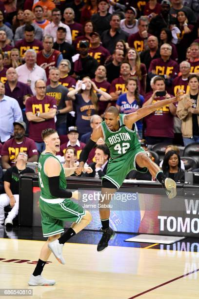 Al Horford celebrates with Jonas Jerebko of the Boston Celtics late in their 111 to 108 win over the Cleveland Cavaliers during Game Three of the...