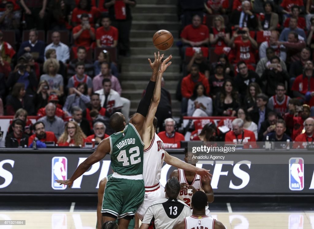 Al Horford (42) of Boston Celtics in action against Robin Lopez (8) of Chicago Bulls during the NBA match between Chicago Bulls vs Boston Celtics at the United Center in Chicago, Illinois, United States on April 21, 2017.