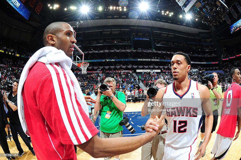 Al Horford #15 of the Atlanta Hawks and John Jenkins #12 of the Atlanta Hawks congratulate each other after winning during the Game Three of the Eastern Conference Quarterfinals between the Indiana Pacers and the Atlanta Hawks in the 2013 NBA Playoffs on April 27, 2013 at Philips Arena in Atlanta, Georgia.