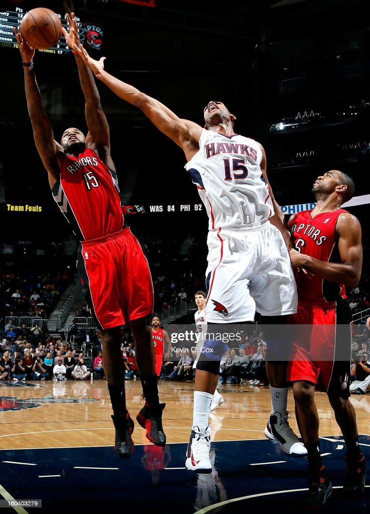 Al Horford #15 of the Atlanta Hawks battles for a rebound against Amir Johnson #15 and Alan Anderson #6 of the Toronto Raptors at Philips Arena on January 30, 2013 in Atlanta, Georgia.