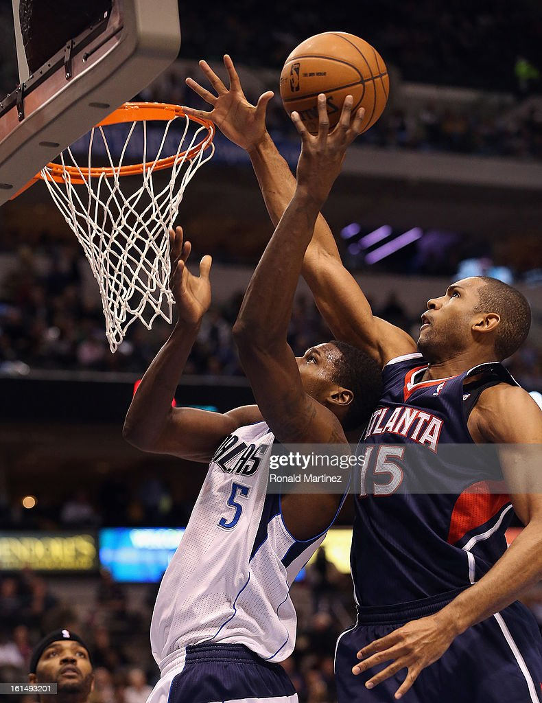 Al Horford #15 of the Atlanta Hawks blocks a shot attempt by Bernard James #5 of the Dallas Mavericks at American Airlines Center on February 11, 2013 in Dallas, Texas.