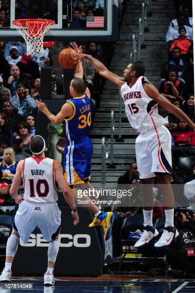 Al Horford of the Atlanta Hawks blocks the shot attempt of Stephen Curry of the Golden State Warriors on December 29 2010 at Philips Arena in Atlanta...