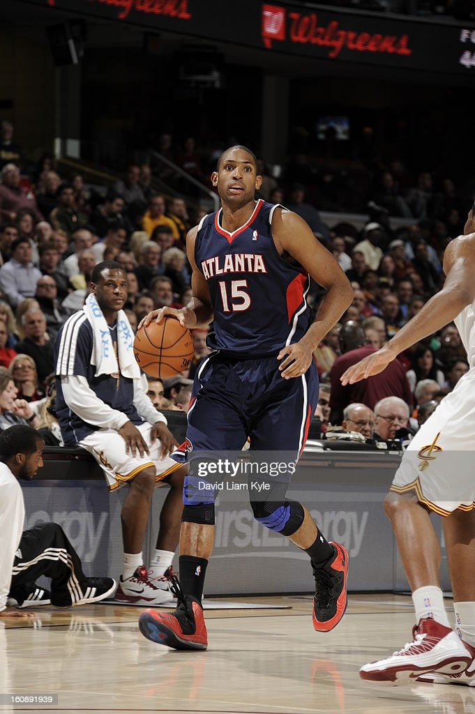 <a gi-track='captionPersonalityLinkClicked' href=/galleries/search?phrase=Al+Horford&family=editorial&specificpeople=699030 ng-click='$event.stopPropagation()'>Al Horford</a> #15 of the Atlanta Hawks brings the ball up court against the Cleveland Cavaliers at The Quicken Loans Arena on January 9, 2013 in Cleveland, Ohio.