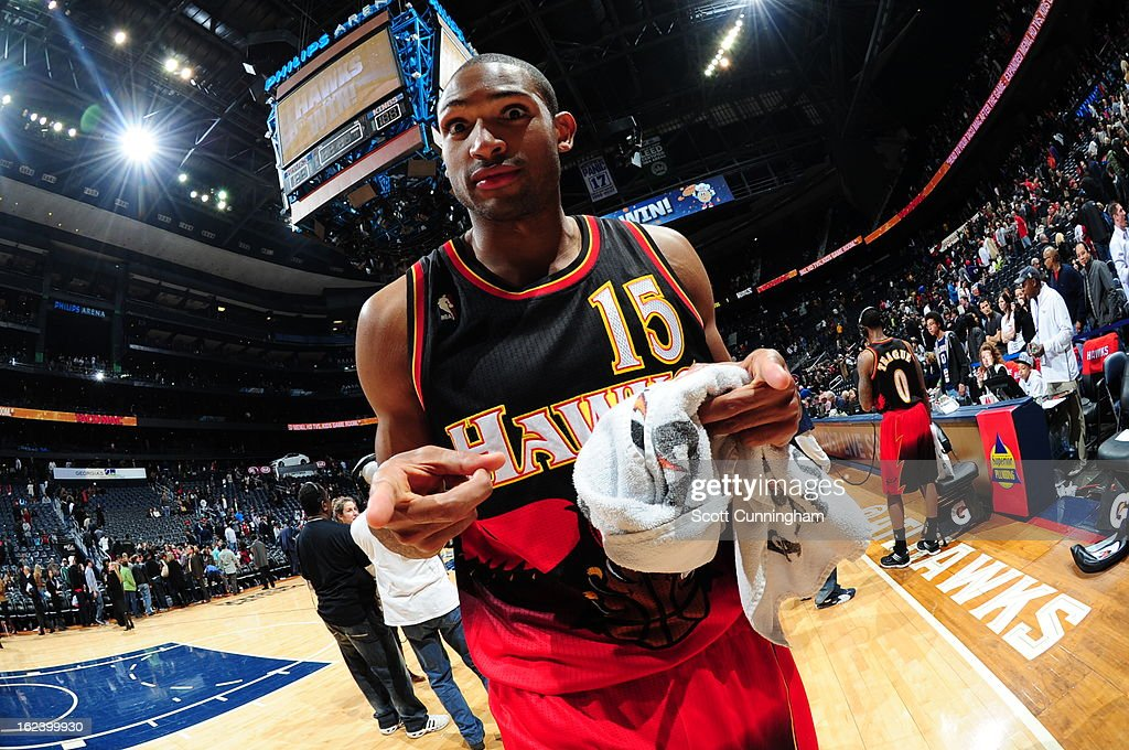 <a gi-track='captionPersonalityLinkClicked' href=/galleries/search?phrase=Al+Horford&family=editorial&specificpeople=699030 ng-click='$event.stopPropagation()'>Al Horford</a> #15 of the Atlanta Hawks celebrates a win after the game against the Sacramento Kings on February 22, 2013 at Philips Arena in Atlanta, Georgia.