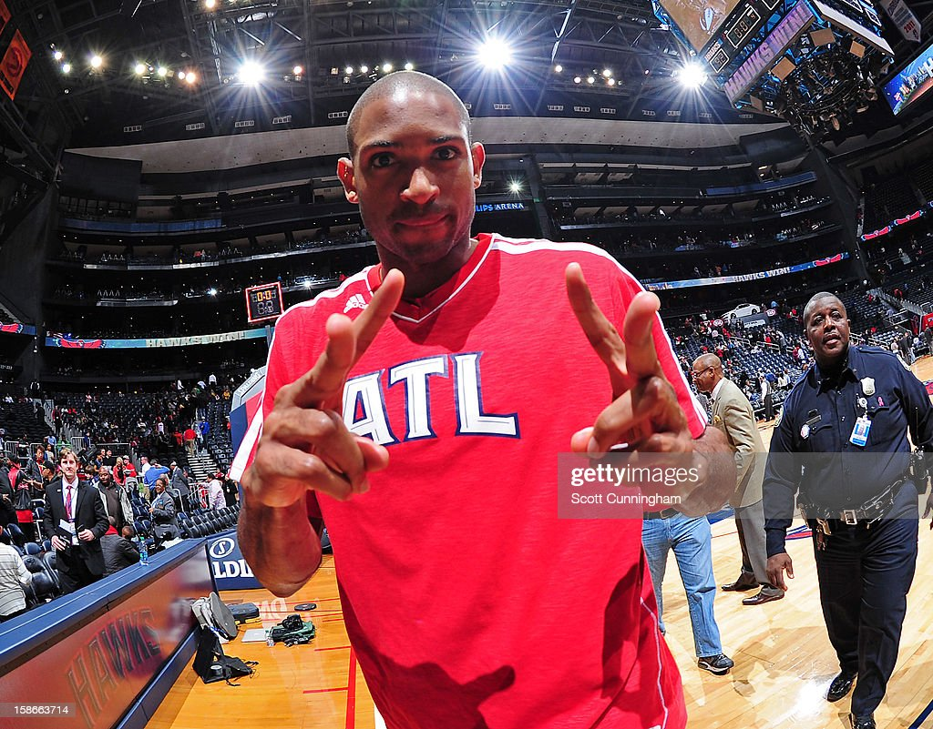 <a gi-track='captionPersonalityLinkClicked' href=/galleries/search?phrase=Al+Horford&family=editorial&specificpeople=699030 ng-click='$event.stopPropagation()'>Al Horford</a> #15 of the Atlanta Hawks celebrates following his team's victory against the Chicago Bulls on December 22, 2012 at Philips Arena in Atlanta, Georgia.
