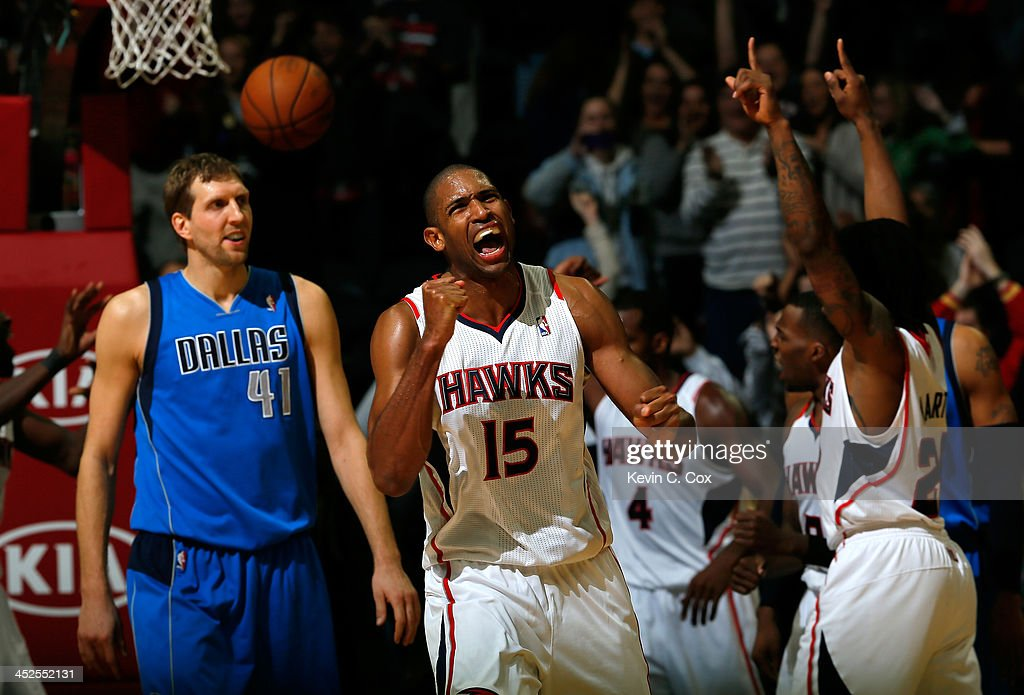 <a gi-track='captionPersonalityLinkClicked' href=/galleries/search?phrase=Al+Horford&family=editorial&specificpeople=699030 ng-click='$event.stopPropagation()'>Al Horford</a> #15 of the Atlanta Hawks celebrates their 88-87 win over <a gi-track='captionPersonalityLinkClicked' href=/galleries/search?phrase=Dirk+Nowitzki&family=editorial&specificpeople=201490 ng-click='$event.stopPropagation()'>Dirk Nowitzki</a> #41 of the Dallas Mavericks at Philips Arena on November 29, 2013 in Atlanta, Georgia.