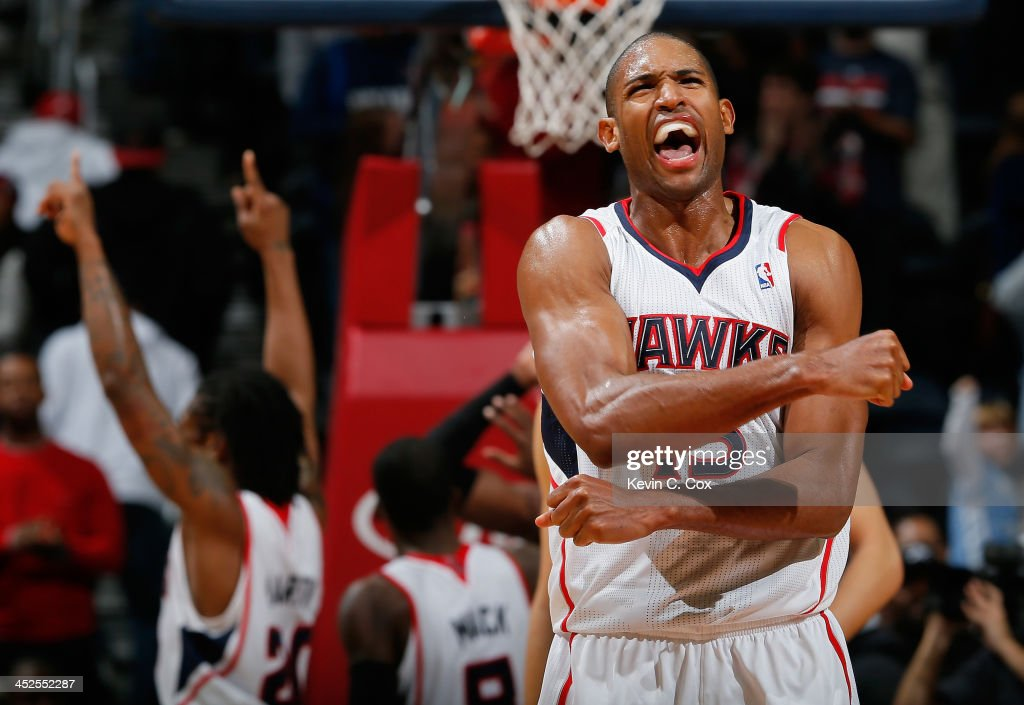<a gi-track='captionPersonalityLinkClicked' href=/galleries/search?phrase=Al+Horford&family=editorial&specificpeople=699030 ng-click='$event.stopPropagation()'>Al Horford</a> #15 of the Atlanta Hawks celebrates their 88-87 win over the Dallas Mavericks at Philips Arena on November 29, 2013 in Atlanta, Georgia.
