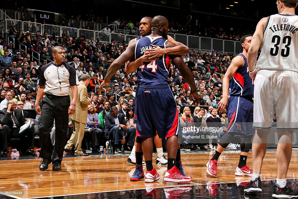 Al Horford #15 of the Atlanta Hawks celebrates with teammate Ivan Johnson #44 during a game against the Brooklyn Nets on March 17, 2013 at the Barclays Center in the Brooklyn borough of New York City.