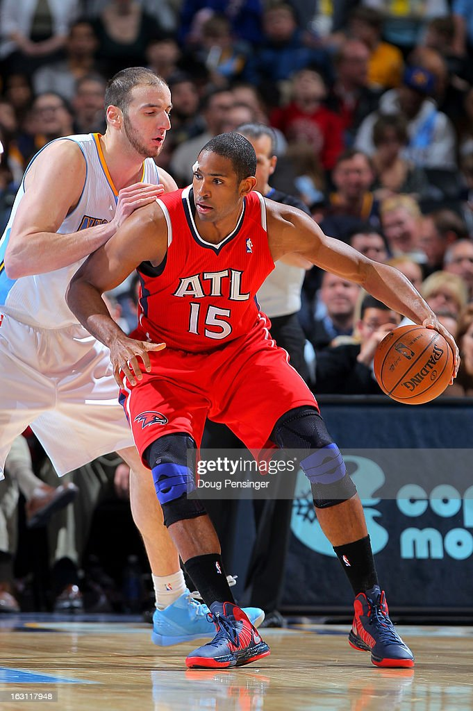 Al Horford #15 of the Atlanta Hawks controls the ball against Kosta Koufos #41 of the Denver Nuggets at the Pepsi Center on March 4, 2013 in Denver, Colorado. The Nuggets defeated the Hawks 104-88.