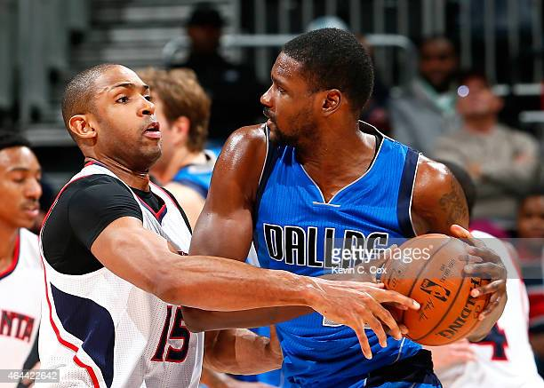 Al Horford of the Atlanta Hawks defends against Bernard James of the Dallas Mavericks at Philips Arena on February 25 2015 in Atlanta Georgia NOTE TO...
