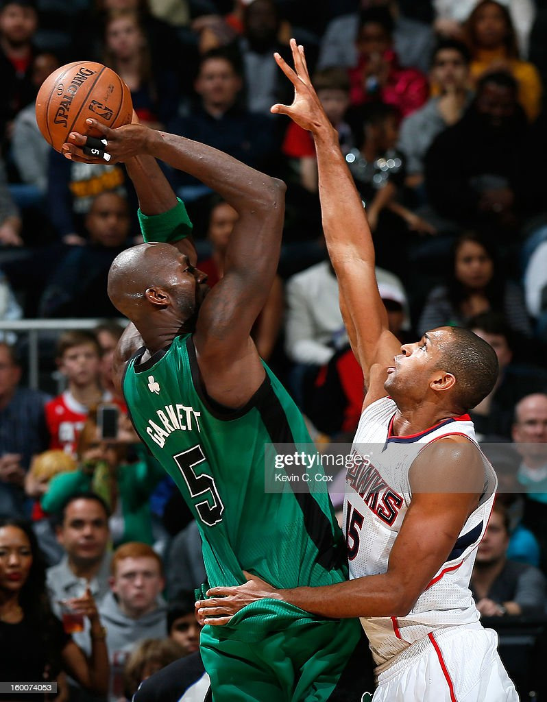Al Horford #15 of the Atlanta Hawks defends against Kevin Garnett #5 of the Boston Celtics in the first overtime at Philips Arena on January 25, 2013 in Atlanta, Georgia.